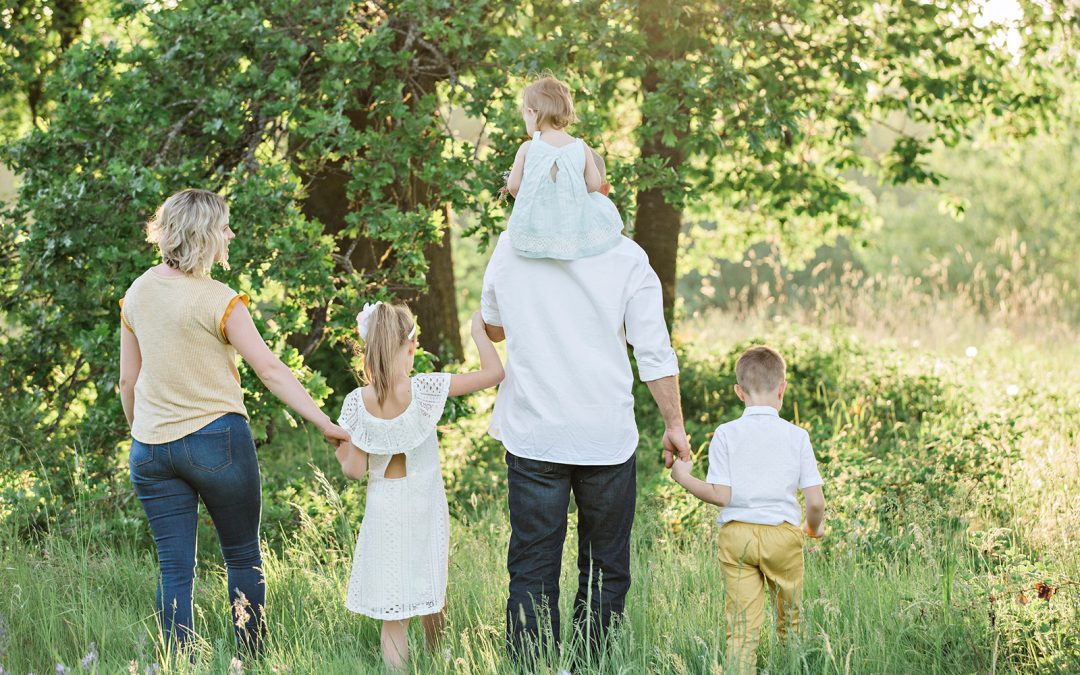 Family of 5 walking in the woods