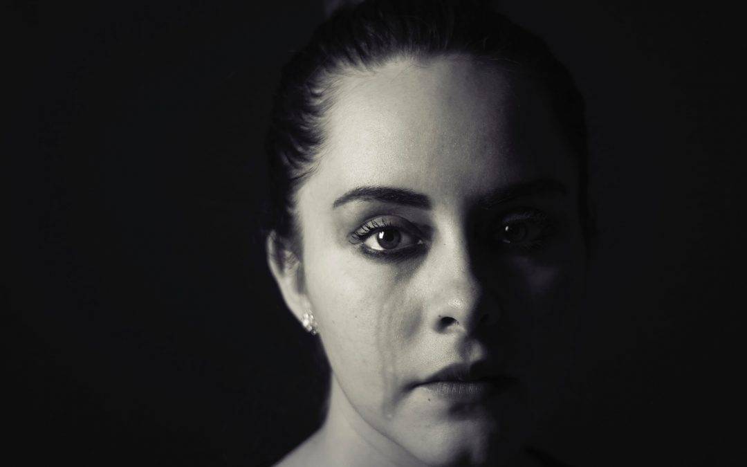 Does grief Cause suffering - woman crying